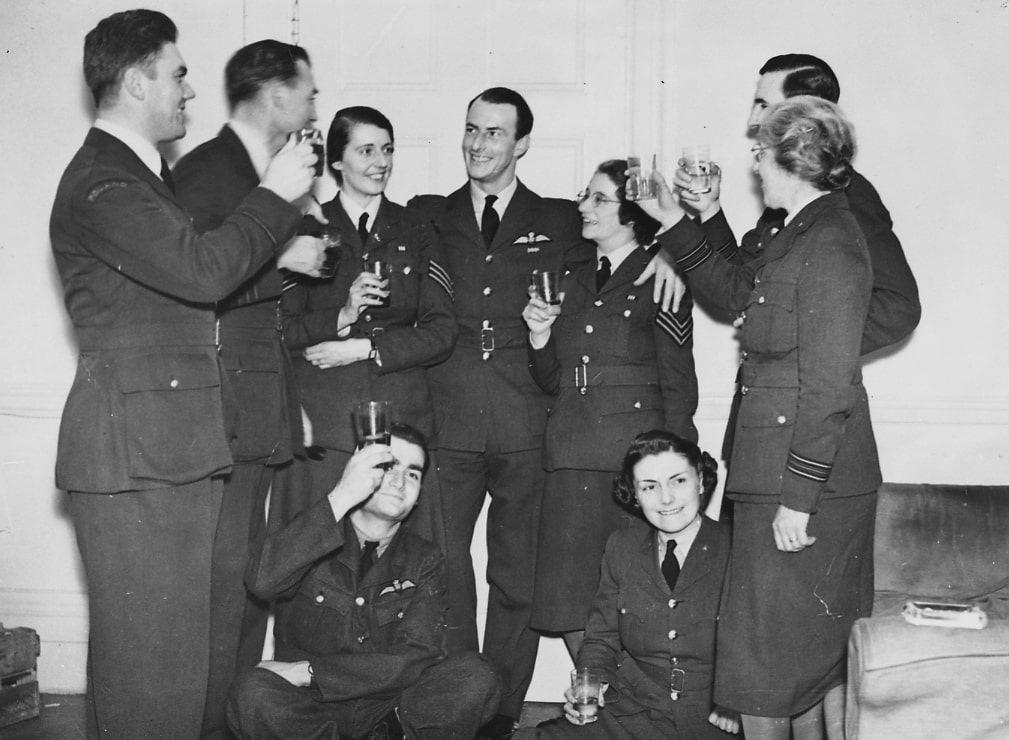Group of men and women in uniform toasting with a drink